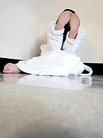 Girl huddling on hospital floor