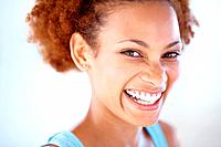 Closeup portrait of a cheerful young woman smiling