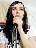 Young female singer in front of microphone