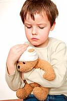 Boy Holding Bandaged Teddy