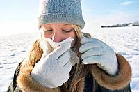 Teenage Girl in Winter Landscape Blowing Her Nose