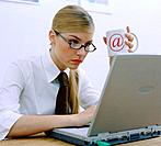 Woman Sitting in Front of Laptop