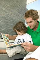 Father and Son with Picture Book