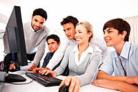 Group of business people preparing presentation on computer