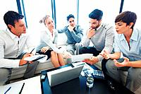 Female leader discussing paper work with his team during meeting