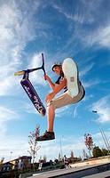 Teenager with city scooter in Skate park, Irun, Gipuzkoa, Euskadi, Spain
