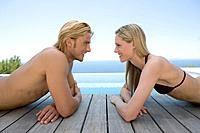 Young Couple Lying Face to Face on Jetty