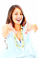 Portrait of happy smiling girl pointing at you with both hands over white background
