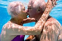 Senior Couple Kissing in Swimming Pool
