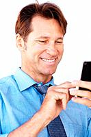 Portrait of a young businessman texting form his mobile phone against white background