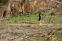 runner in field in countryside