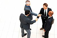 Top view of group of business men shaking hands