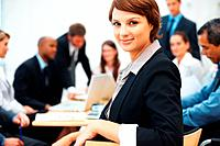 Beautiful young business woman during meeting