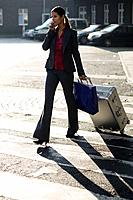 Businesswoman Walking with Suitcase