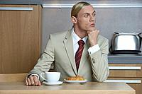 Businessman at Breakfast in Sleek Modern Kitchen