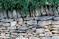 Fence med of dried flat stones in The Bories Village in Provence, France
