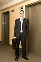 Businessman Standing Beside Elevator