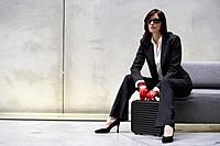 Businesswoman With Briefcase and Red Racing Gloves