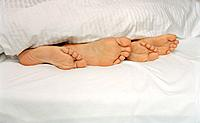 Feet at the Foot of the Bed