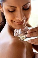 Young Woman Putting on Oil