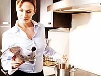 Woman Reading Magazine while Cooking