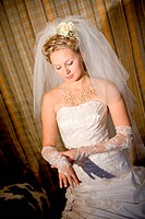 bride puts on a white glove