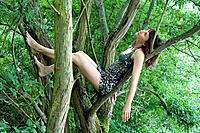 Woman in Sequin Dress in Tree