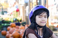 Little girl with bike helmet on bicycle