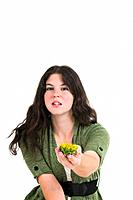 Young female teen offers the viewer a sunflower in the palm of her hand  Focus on flower
