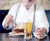 Man Eating Meal with Pint of Beer