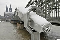 snowcovered shortsight glass pointing on Cologne Cathedral an Hohenzollenrbruecke, Hohenzollern bridge