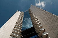 Modern office center under blue sky with clouds