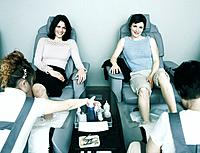 Women Receiving Pedicures at Beauty Shop