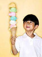 Boy Holding Ice Cream Cone with Seven Scoops