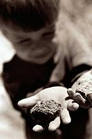 Boy Holding Rocks