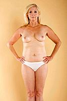 Portrait of a middle aged woman with exposed body