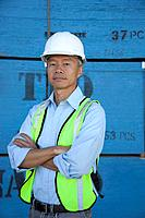 Portrait of a middle_aged warehouse worker standing with arms crossed