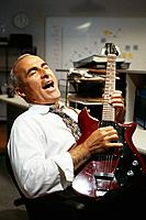Businessman Playing Electric Guitar
