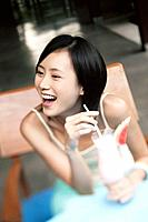 Woman Laughing over Drink