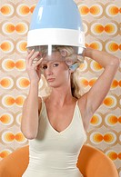 young woman in a seventies ambiance under a drying hood