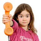 Little Girl handing the telephone receiver to her parents
