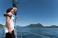 Older couple standing on boat together