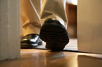Man´s Feet Walking Through Doorway