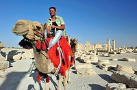 Great Colonnade and Monumental Arch  palmyra, Syria  Bedouin man and his camel.