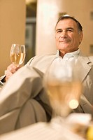 Businessman having glass of wine