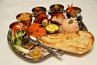 Thali, Traditional Indian platter of starters, curry, and deserts.
