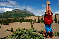 Woman doing Yoga, Carcross Desert, Yukon Territory