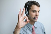 Young Man Wearing Headset Doing OK Hand Sign