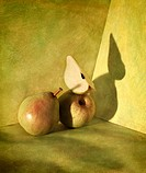 Still life with pears and dramatic shadow styled with a retro feel
