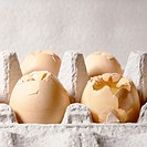 Shattered eggs in egg carton